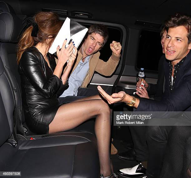 Noel Gallagher Sara MacDonald and Mark Ronson at the Chiltern Firehouse on October 19 2015 in London England