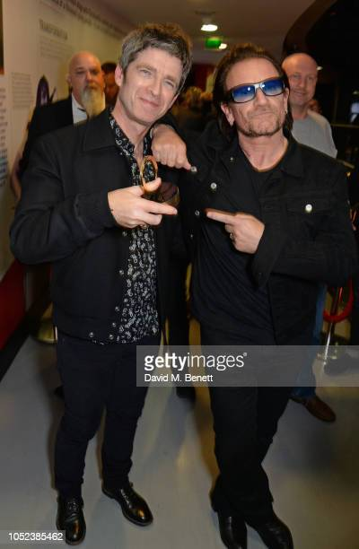 Noel Gallagher winner of the Q Outstanding Contribution To Music award and Bono pose at the Q Awards 2018 at The Roundhouse on October 17 2018 in...