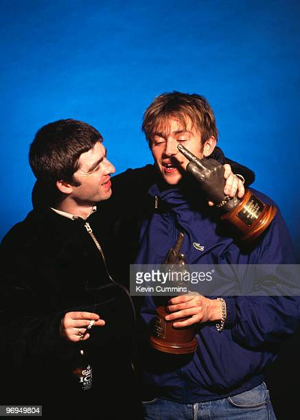 Noel Galllagher of Oasis and Damon Albarn of Blur holding awards at the 1995 NME Brat Awards held in London England in February 1995