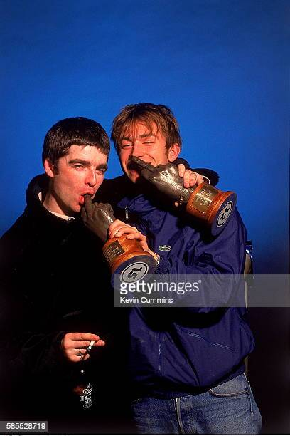 Noel Galllagher of Oasis and Damon Albarn of Blur holding their trophies at the 1995 NME Brat Awards held in London February 1995