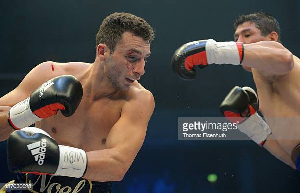 Noel Gevor of Germany exchanges punches with Daniel Sanabria of Argentina during their WBO international cruiserweight championship fight at the...