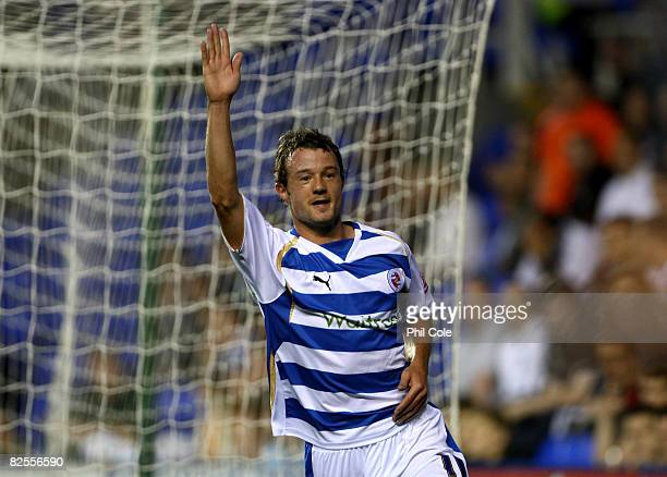 Noel Hunt of Reading celebrates scoring during the second round match of the Carling Cup between Reading and Luton Town at the Madejski Stadium on...