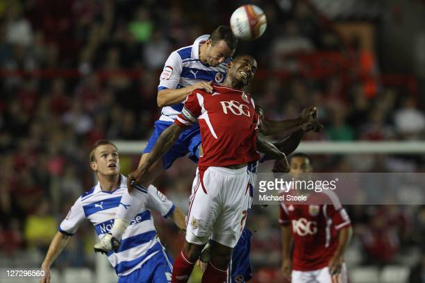 Noel Hunt of Reading heads clear above Marvin Elliott of Bristol City during the npower Championship match between Bristol City and Reading at Ashton...