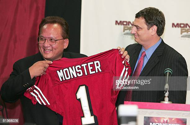 Noel Lee founder of Monster Cable Company holds a jersey presented from David Peart VP of Marketing and sales for the 49ers at a press conference...