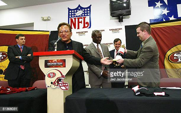 Noel Lee founder of Monster Cable Company presents gifts at a press conference announcing the naming rights of the San Francisco 49ers stadium to...