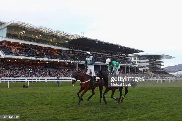 Noel McParlan L riding Missed Approach crosses the finishing line alongside Patrick Mullins riding Mall Dini after victory in the Fulke Walwyn Kim...