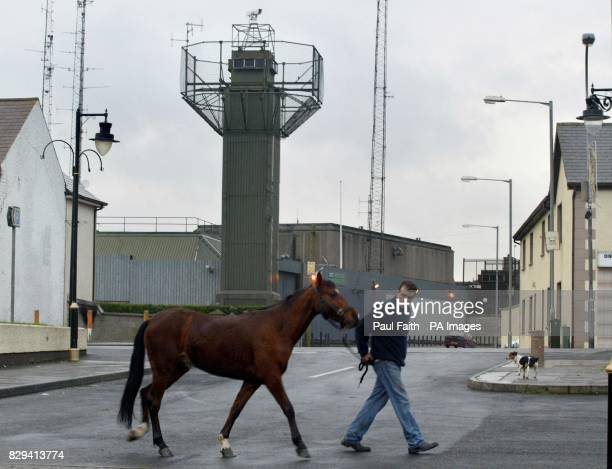 Noel McSorley from Crossmaglen Armagh walks his horse in the square in Crossmaglen under the shadow of the police station and military watch tower