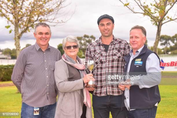 Noel Mendy representing Quambatook Racing Club race sponsor Judy Cameron Symon Wilde and Swan Hill Jockey Club President Jack Bennett after winning...