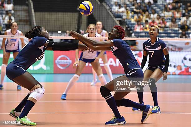 Noel Murambi and Triza Atuka of Kenya receive the ball in the match between Russia and Kenya during the FIVB Women's Volleyball World Cup Japan 2015...