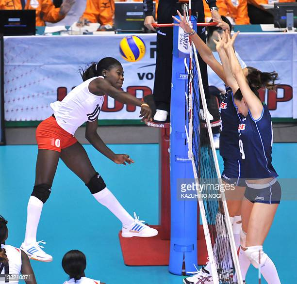 Noel Murambi of Kenya attacks against Italy during a match of the World Cup women's volleyball tournament in Tokyo on November 18 2011 Italy beat...