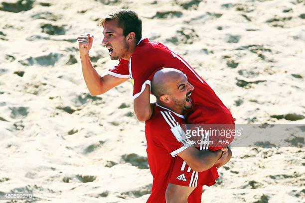 Noel Ott of Switzerland celebrates a goal with team mate Samuel Lutz during the FIFA Beach Soccer World Cup Portugal 2015 Group B match beween...