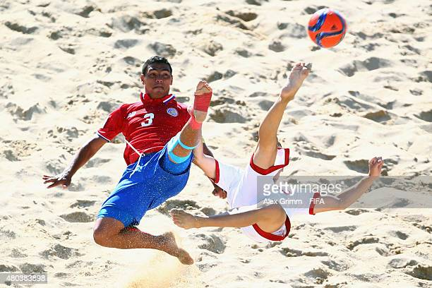 Noel Ott of Switzerland does a bicycle kick next to Jose Mendoza of Costa Rica during the FIFA Beach Soccer World Cup Portugal 2015 Group B match...