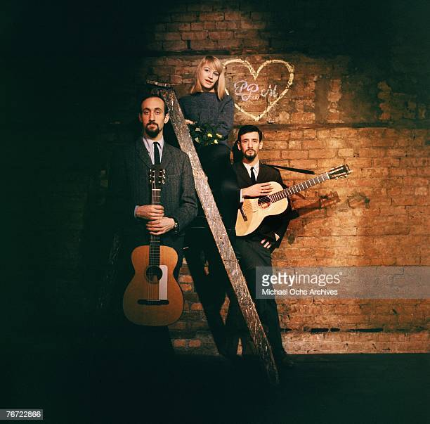 Noel Paul Stookey Mary Travers and Peter Yarrow of Peter Paul and Mary pose for alternative shots for the cover of their first eponymouslytitled...