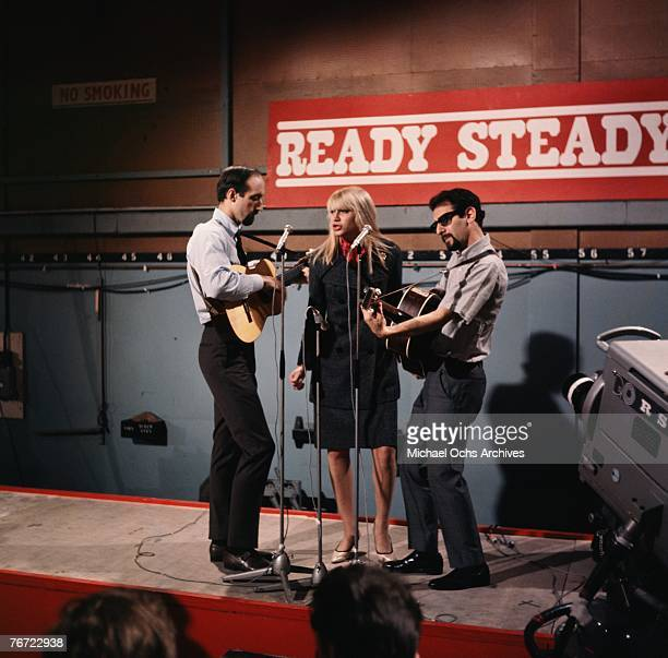 Noel Paul Stookey Mary Travers and Peter Yarrow of Peter Paul and Mary perform Tell It to the Mountain on British television show Ready Steady Go on...