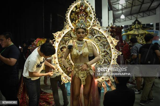 Noel Tokuhisa of Sri Lanka has her elaborate national costume fitted backstage during the Miss International Queen 2018 transgender beauty pageant in...