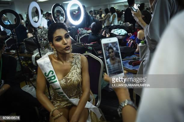 Noel Tokuhisa of Sri Lanka speaks on social media in the dressing room before the final round of the Miss International Queen 2018 transgender beauty...