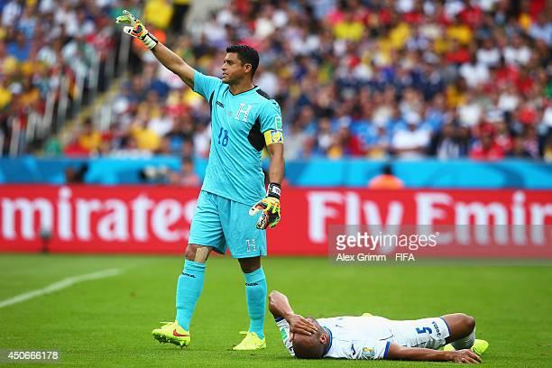 Noel Valladares of Honduras gestures after Victor Bernardez of Honduras goes down during the 2014 FIFA World Cup Brazil Group E match between France...
