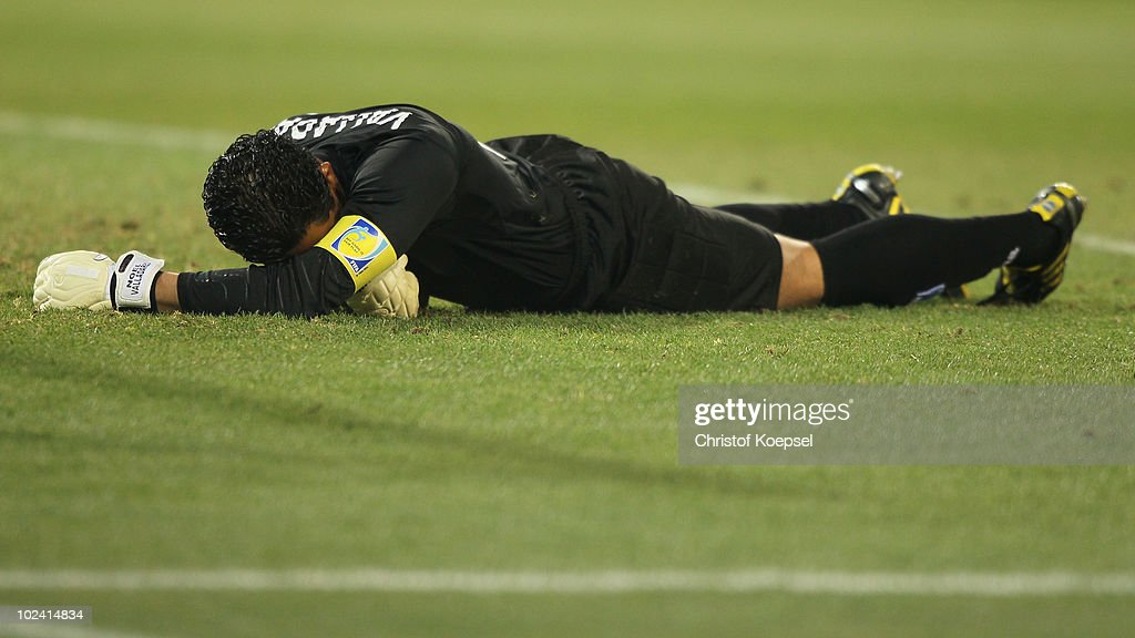 Noel Vallardes of Honduras reacts to his injured back during the 2010 FIFA World Cup South Africa Group H match between Switzerland and Honduras at the Free State Stadium on June 25, 2010 in Mangaung, Bloemfontein, South Africa.