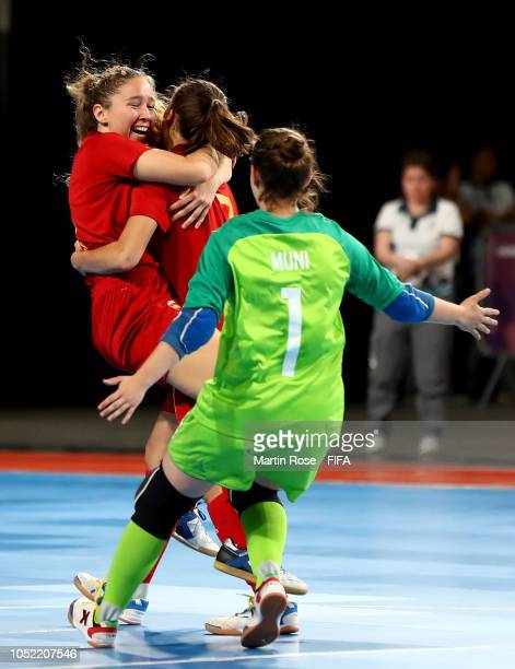 Noelia de las Heras of Spain celebrate with her team mates after she scores the opening goal in the Women's Futsal semi final match between Spain and...