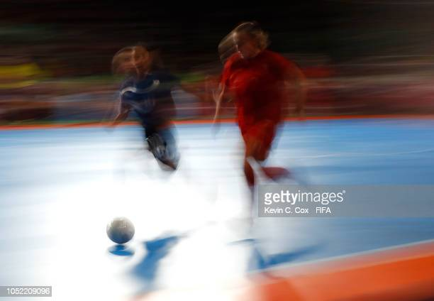 Noelia de las Heras of Spain controls the ball against Aki Ikeuchi of Japan in the Women's Futsal semifinal match between Spain and Japan during the...