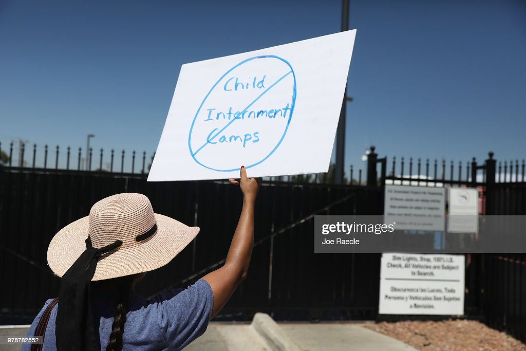 Noelle Andrade and others protest the separation of children from their parents in front of the El Paso Processing Center, an immigration detention facility, at the Mexican border on June 19, 2018 in El Paso, Texas. The separations have received intense scrutiny as the Trump administration institutes a zero tolerance policy on illegal immigration.