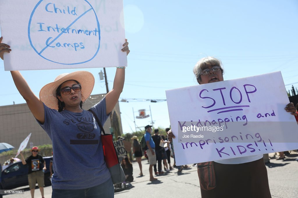 Noelle Andrade (L), her mother Armida Hernandez and others protest the separation of children from their parents in front of the El Paso Processing Center, an immigration detention facility, at the Mexican border on June 19, 2018 in El Paso, Texas. The separations have received intense scrutiny as the Trump administration institutes a zero tolerance policy on illegal immigration.