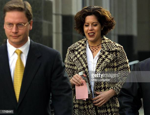 Noelle Bush leaves Orange County Courthouse with her attorney Dean Cannon after her regularlyscheduled court appearance January 24 2003 in Orlando...
