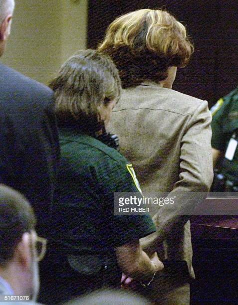 Noelle Bush niece of US President George W Bush and daughter of Florida Governor Jeb Bush is handcuffed by an Orange County Courthouse bailiff at the...