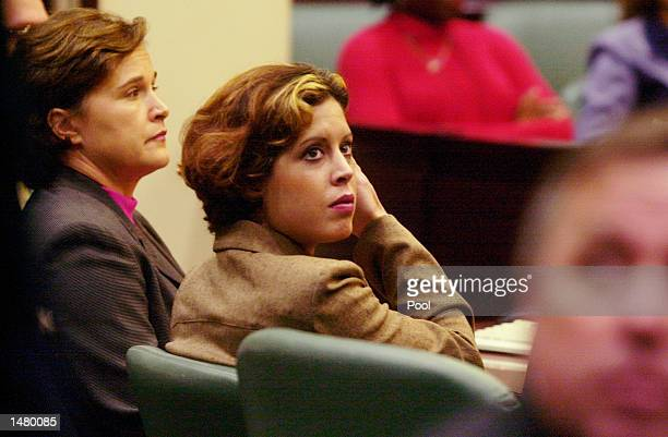 Noelle Bush waits with her aunt Dorothy Bush Koch for the start of her drug court hearing in an Orange County courtroom October 17 2002 in Orlando...