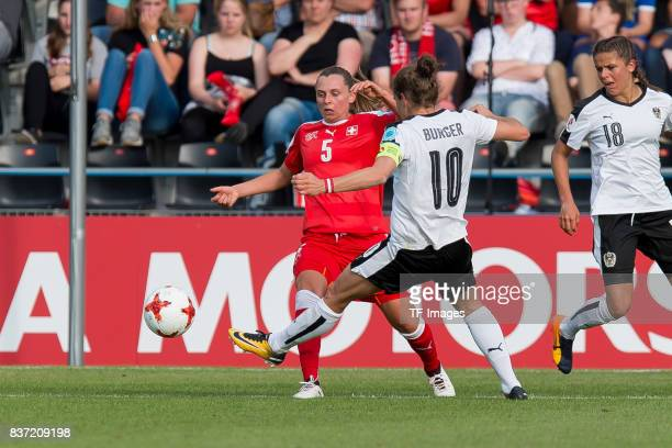 Noelle Maritz of Switzerland and Nina Burger of Austria battle for the ball during the Group C match between Austria and Switzerland during the UEFA...