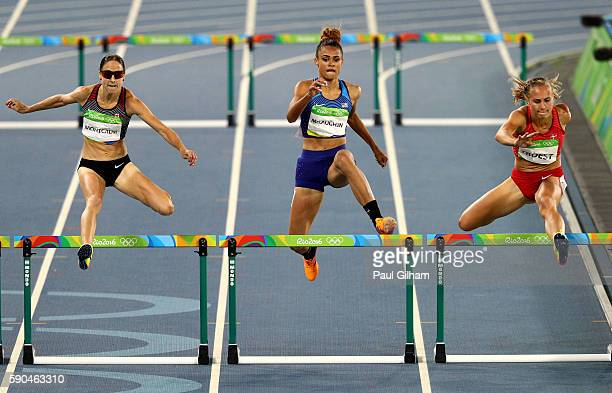 Noelle Montcalm of Canada Sydney McLaughlin of the United States and Stina Troest of Denmark compete during the Women's 400m Hurdles Semifinals on...
