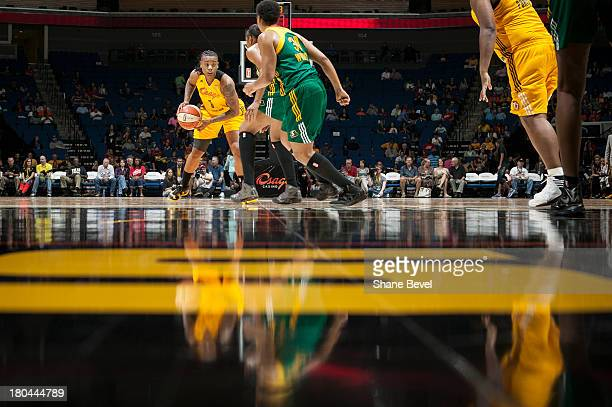 Noelle Quinn and Tanisha Wright of the Seattle Storm defend Riquna Williams of the Tulsa Shock during the WNBA game on September 12 2013 at the BOK...