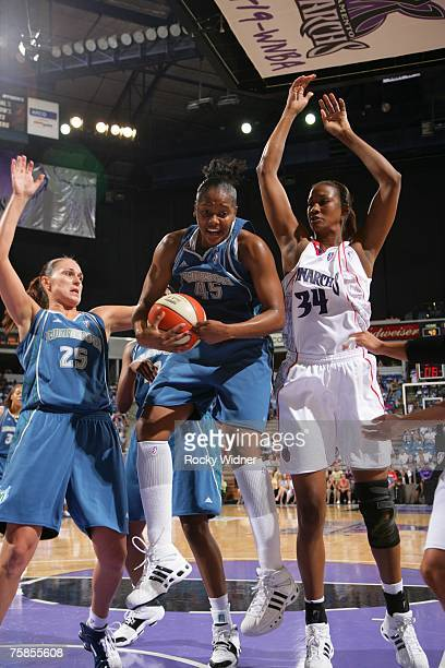 Noelle Quinn of the Minnesota Lynx grabs the rebound against Adrian Williams of the Sacramento Monarchs at ARCO Arena on July 29 2007 in Sacramento...