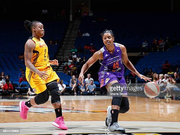 Noelle Quinn of the Phoenix Mercury handles the ball against Riquna Williams of the Tulsa Shock on August 18 2015 at the BOK Center in Tulsa Oklahoma...