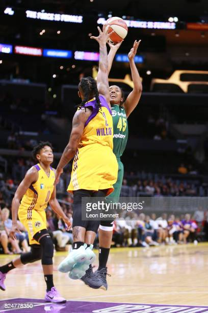 Noelle Quinn of the Seattle Storm handles the ball against Riquna Williams of the Los Angeles Sparks during a WNBA basketball game at Staples Center...