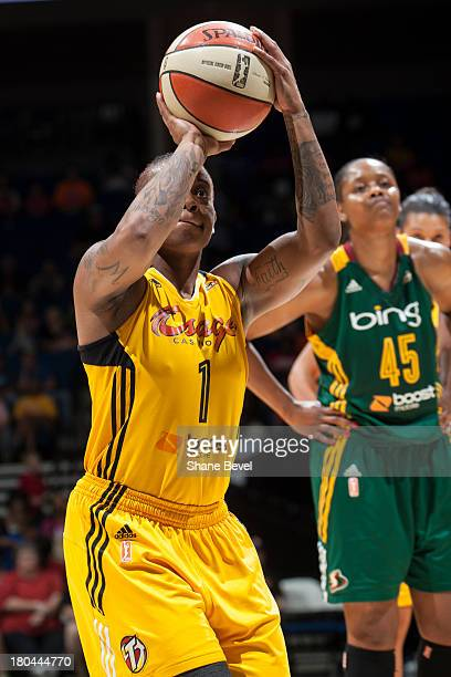 Noelle Quinn of the Seattle Storm watches as Riquna Williams of the Tulsa Shock shoots from the free throw line during the WNBA game on September 12...