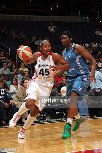 Noelle Quinn of the Washington Mystics moves the ball against Amber Harris of the Minnesota Lynx at the Verizon Center on May 30 2012 in Washington...