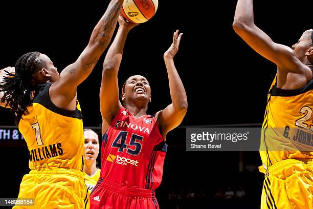 Noelle Quinn of the Washington Mystics shoots against Riquna Williams and Glory Johnson of the Tulsa Shock during the WNBA game on July 8 2012 at the...