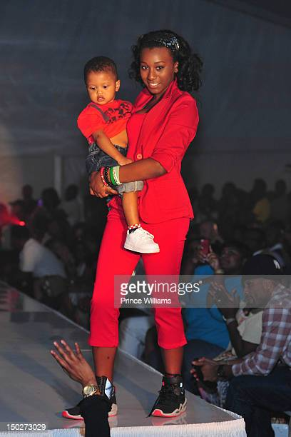 Noelle Robinson and Ayden Nida attend the Runway Red Celebrity Kids fashion show at Zoo Atlanta on August 11 2012 in Atlanta Georgia