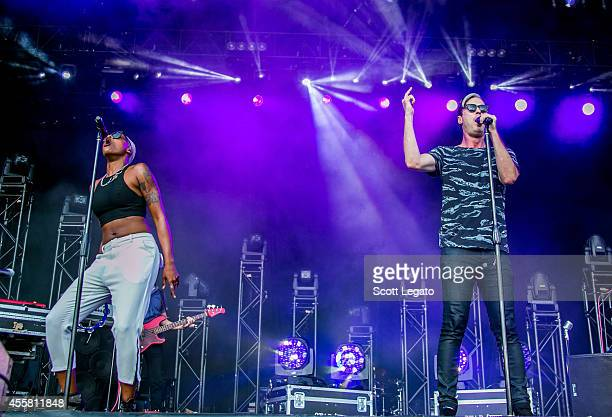 Noelle Scaggs and Michael Fitzpatrick of Fitz and the Tantrums perform during the 2014 Music Midtown Festival at Piedmont Park on September 20 2014...