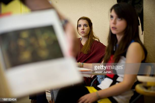 Noemi Antioquia twentythree years old from Madrid sits next to her classmate Marta Gamarra twentythree years old from Madrid as they listen to...