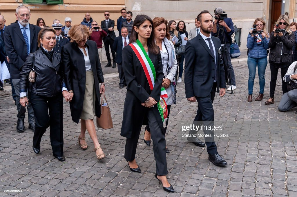 Noemi Di Segni, President of the Union of Italian Jewish Communities, Virginia Raggi, Mayor of Rome, Ruth Dureghello, President of the Jewish Community of Rome and Gadiel Gaj Tache, who was wounded and whose younger brother died in the attack during the commemoration of the 1982 terrorist attack at the Great Synagogue of Rome 1982 on October 9, 2017 in Rome, Italy. On October 9, 1982, 2 year old Stefano Gaj Tache was killed and 37 people were injured when Palestinian militants opened fire on families leaving the synagogue on the Jewish Holiday of Shemini Atzeret.