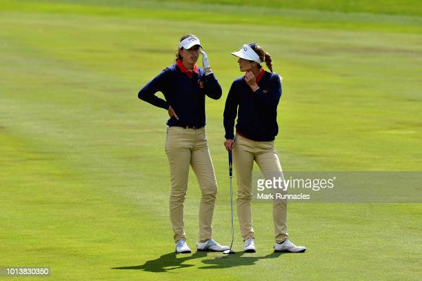 Noemi Jimenez and Silvia Banon of Spain talk on hole twelve during match 4 of Group A during day two of the European Golf Team Championships at...