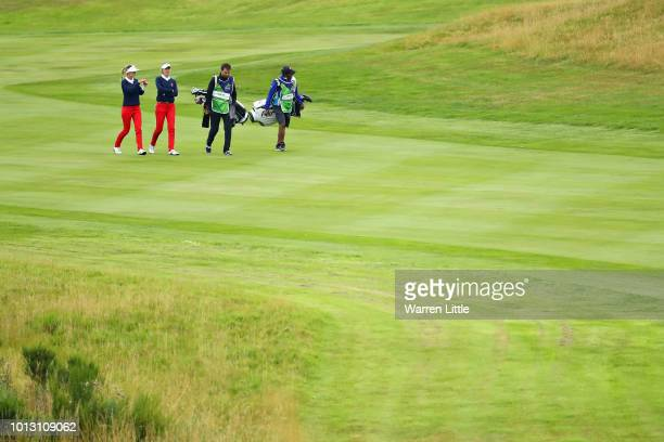 Noemi Jimenez and Silvia Banon of Spain walk on hole ten during match 1 of Group A during day one of the European Golf Team Championships at...