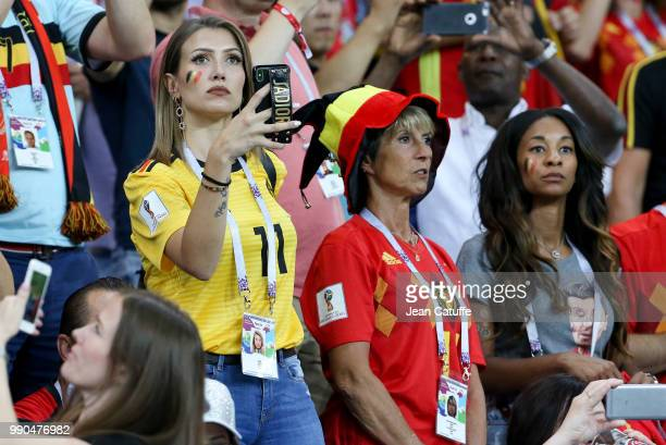 Noemie Happart Carrasco wife of Yannick Carrasco of Belgium Deborah Panzokou partner of Thomas Meunier during the 2018 FIFA World Cup Russia Round of...