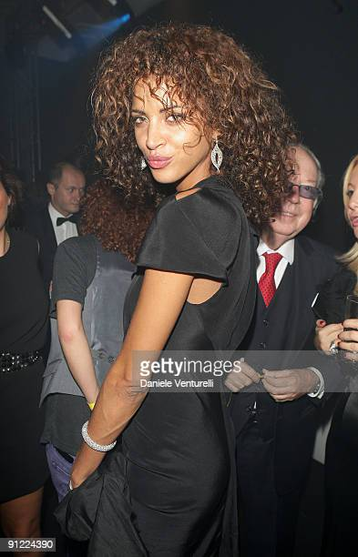 Noemie Lenoir attends amfAR Milano 2009 After Party the Inaugural Milan Fashion Week event at La Permanente on September 28 2009 in Milan Italy