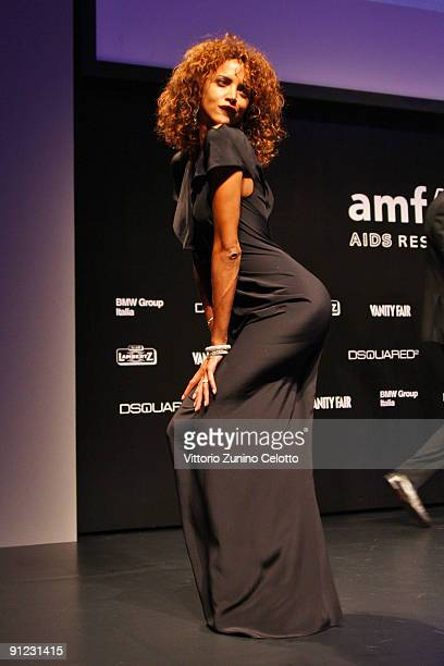 Noemie Lenoir attends amfAR Milano 2009 Auction And Show the Inaugural Milan Fashion Week event at La Permanente on September 28 2009 in Milan Italy