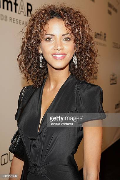 Noemie Lenoir attends amfAR Milano 2009 Red Carpet the Inaugural Milan Fashion Week event at La Permanente on September 28 2009 in Milan Italy
