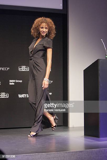 Noemie Lenoir attends the amfAR Milano 2009 Auction And Show the Inaugural Milan Fashion Week event at La Permanente on September 28 2009 in Milan...