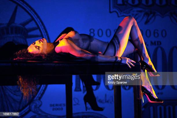 Noemie Lenoir performs onstage at Le Crazy Horse on May 29 2013 in Paris France